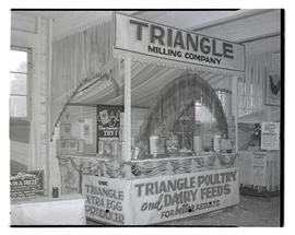 Triangle Milling Company booth, probably at Pacific International Livestock Exposition
