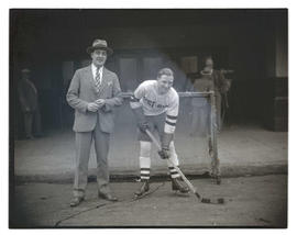 West Side hockey player and unidentified man