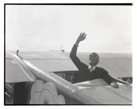 Dick Rankin? waving from refueling compartment of airplane On-to-Oregon
