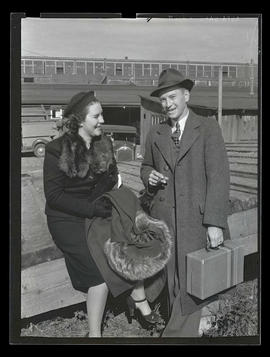 Unidentified woman and man outdoors, probably at Pacific International Livestock Exposition