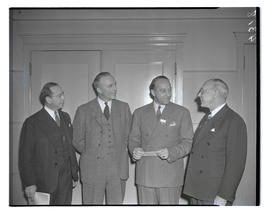 Four unidentified men at convention