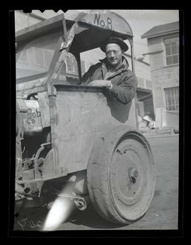 Worker in vehicle, Albina Engine & Machine Works, Portland