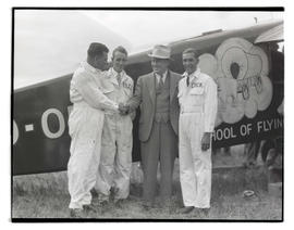 Tex Rankin, Dud Rankin, Oakley G. Kelly, and Dick Rankin with airplane On-to-Oregon