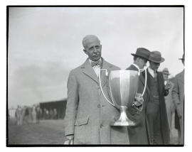 Man holding trophy