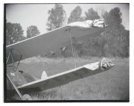 Damaged airplane in field