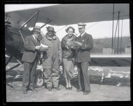 Tex Rankin, Dorothy Hester, and two unidentified men next to plane