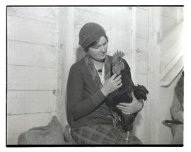 Woman holding rooster