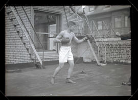 Unidentified boxer, posing with his fists up