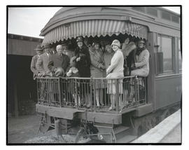Exhibitors on train arriving at livestock show