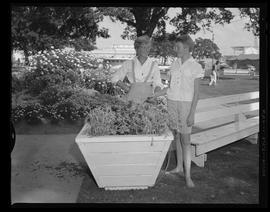 Women Stand by Planter Box at the Oregon State Fair