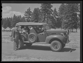 Men with military vehicle at Vancouver Barracks