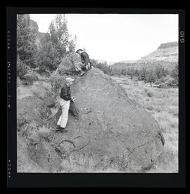 Two men with petroglyphs at Cove Palisades State Park