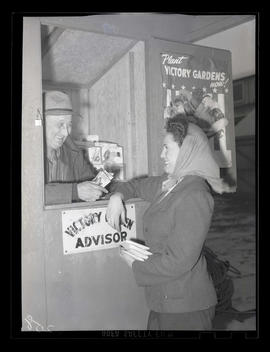 Employee visiting victory garden advice booth at Albina Engine & Machine Works, Portland