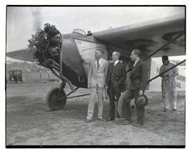 Three men with Pacific Air Transport plane