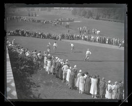 Crowd watching golf tournament