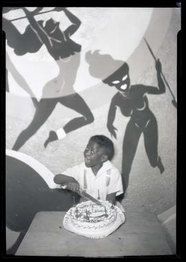 Teddy McDaniel posing with birthday cake at Cotton Club, Portland