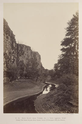 """O.32. Rock Bluff from Tunnel No. 3. View Looking West."""