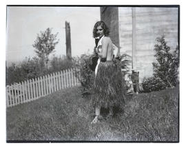 Unidentified woman in costume at outdoor party?