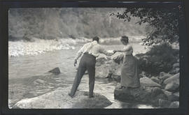 Man and woman by river
