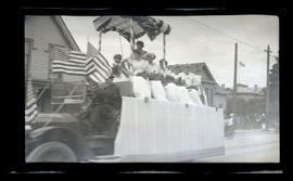 Women on parade float, possibly in Astoria
