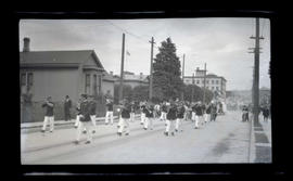 Band marching in parade, possibly in Astoria