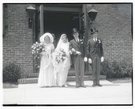 Unidentified wedding party at entrance to building
