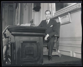 Fred E. Kiddle sitting at head of Senate chambers, Oregon State Capitol