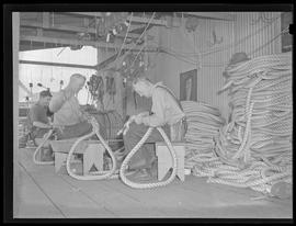 Workers braiding rope at Commercial Iron Works, Portland