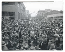 Crowd filling street, possibly Northwest 9th Avenue, Portland