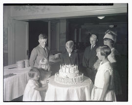 Unidentified children with cake