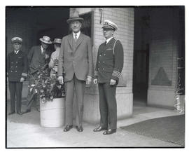 Secretary of the Navy Curtis Dwight Wilbur and unidentified Navy officer