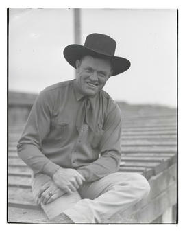 Tom Hogan, half-length portrait, probably at Pacific International Livestock Exposition
