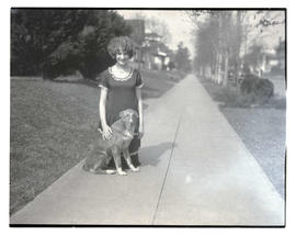 Unidentified girl and dog, full-length portrait