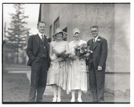 Unidentified wedding party outside building