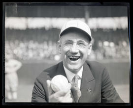 Portrait of man holding baseball during pregame ceremonies