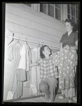 Girls with 4-H clothing display