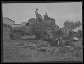 Soldiers collecting scrap iron from automobiles, Portland