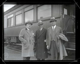 Walter P. Chrysler and two unidentified men next to train car