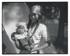 Young Native American woman holding baby