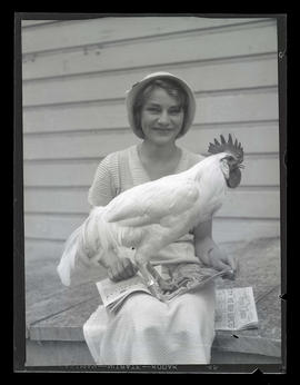 Young woman with rooster