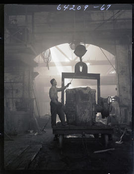 Frank Budrow guiding a crane in the Columbia Steel Casting Company foundry