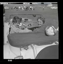 Two people in car at auto races in Tillamook, June 1955