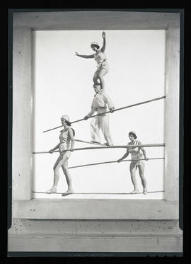 Picture of four people performing high-wire act