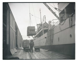 Cargo being hoisted onto ship