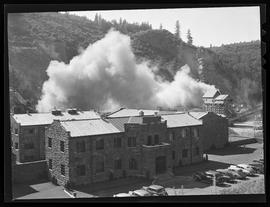 Blasting rock at Rocky Butte quarry, with Multnomah County Jail