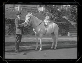 Oswald West holding horse ridden by daughter Jean