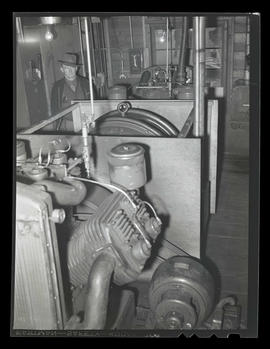 Worker in room filled with machinery, swing shift, Albina Engine & Machine Works, Portland