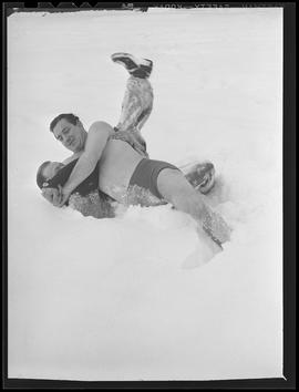 Wrestlers George Wagner and Bill McEuin in snow bank