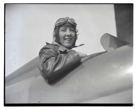 Woman seated in airplane