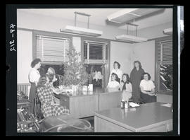 Women in office with Christmas tree